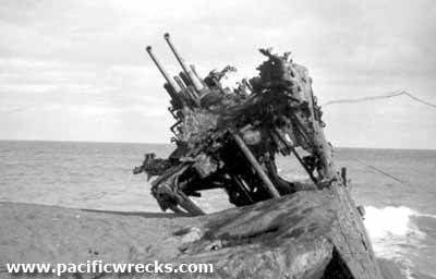 Pacific Wrecks - Beached Destroyer bow with anti-aircraft guns on Iwo Jima